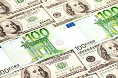 Um montão dos dólares e de euro- notas Fotos de Stock Royalty Free