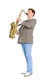 Um músico dos jovens joga o saxofone Foto de Stock Royalty Free