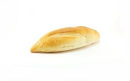 Um naco do pão no fundo branco Imagem de Stock