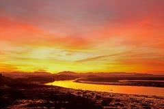 Um nascer do sol alaranjado na ponte de quatro milhas Imagens de Stock