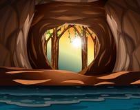 Um nascer do sol na entrada da caverna ilustração royalty free