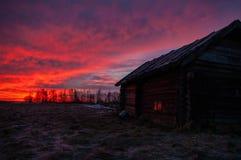 Um nascer do sol na vila Foto de Stock