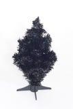 Um Natal artificial preto undecorated Fotos de Stock Royalty Free