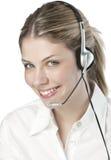 Um operador amigável da secretária/telefone fotografia de stock