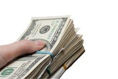 Um pacote de dinheiro à disposicão Foto de Stock