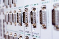 Um painel com muitos conectores do multi-pino imagem de stock