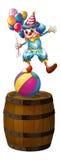 Um palhaço acima do tambor Imagens de Stock