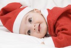 Um Papai Noel engraçado na cama. Imagem de Stock Royalty Free