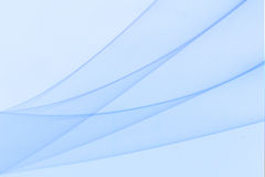 Um papel de parede azul com ondas azuis fotos de stock royalty free