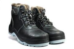 Um par das botas de couro Foto de Stock