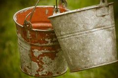 Um par de baldes antigos do metal Foto de Stock