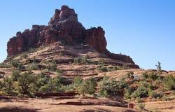 Um par de caminhantes ascensão rocha de Bell Fotografia de Stock Royalty Free