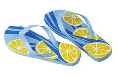 Um par de deslizadores amarelos azuis espertos da praia Imagem de Stock Royalty Free