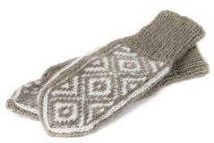 Um par de mitenes feitos malha de lã Foto de Stock Royalty Free