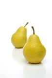 Um par de peras amarelas Fotografia de Stock