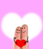 Um par feliz do dedo no amor Imagens de Stock