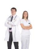 Um par trabalhadores médicos novos na roupa branca Foto de Stock Royalty Free