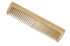 Um pente de madeira com os dentes de larguras diferentes Imagens de Stock Royalty Free