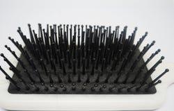 Um pente sujo da escova com fim acima Fotografia de Stock Royalty Free