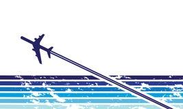 Um plano no vôo Fotos de Stock Royalty Free