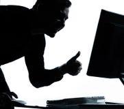 Um polegar do computador da silhueta do homem de negócio acima Imagens de Stock Royalty Free