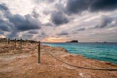Um por do sol dramático em Cala Compte Fotos de Stock