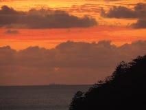 Um por do sol tropical Imagens de Stock