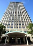 Um prédio de escritórios com guarnição de turquesa Imagens de Stock Royalty Free