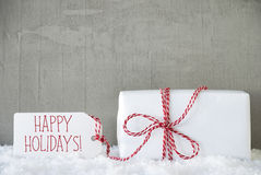 Um presente, fundo urbano do cimento, Text boas festas Imagens de Stock Royalty Free