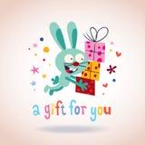 Um presente para você coelho com presentes Imagem de Stock Royalty Free