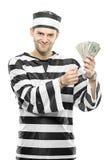 Um prisioneiro com as algemas que prendem dólares americanos Fotografia de Stock Royalty Free