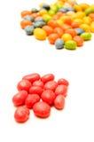 Um punhado de doces vermelhos no primeiro plano Foto de Stock Royalty Free