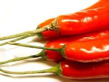 Um punhado de pimentões vermelhos Fotos de Stock