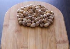 Um punhado de porcas de pistaches Fotografia de Stock