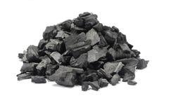 Um punhado do carvão vegetal à terra Fotos de Stock