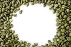 Um quadro dos feijões de café verdes com espaço vazio da cópia fotografia de stock