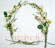 Um quadro feito das flores e da palavra de Imbolc imagem de stock royalty free