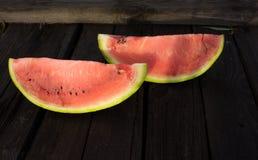 Um quarto de uma melancia em uma tabela de madeira Imagem de Stock Royalty Free
