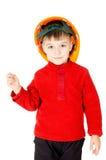 Um rapaz pequeno que está com um capacete foto de stock royalty free