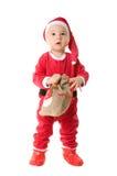 Um rapaz pequeno vestido como Papai Noel. Foto de Stock Royalty Free
