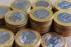 Um real inventa, moeda brasileira imagens de stock
