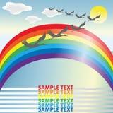 Um rebanho das cegonhas que voam entre as nuvens em um arco-íris Foto de Stock Royalty Free