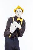 Um retrato de um homem, um ator, uma pantomima, um homem faz a Imagens de Stock Royalty Free