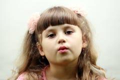 Um retrato de uma menina da criança Fotografia de Stock Royalty Free
