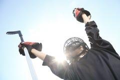 Um retrato do jogador da bola do hóquei com vara de hóquei Imagem de Stock