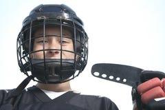 Um retrato do jogador da bola do hóquei com vara de hóquei Imagens de Stock