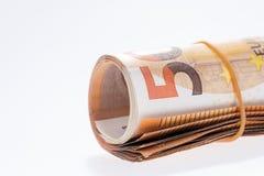 Um rolo com as cinqüênta euro- cédulas no fundo branco Fotografia de Stock