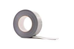 Um rolo do cinza/fita adesiva da prata fotografia de stock