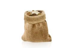 Um saco com dinheiro no fundo branco Fotos de Stock