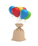 Um saco completo grande amarrado com uma parte de corda e unido a um pacote de balões coloridos Fotos de Stock